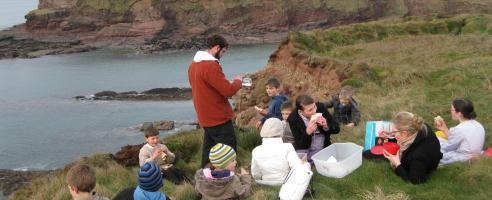 Children gather for an open-air class in Ireland